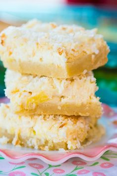 Hawaiian Cheesecake Bars are a decadent bar made with a shortbread crust followed by a pineapple cheesecake layer, topped with buttery toasted coconut !