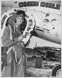 "1st. Lt. Walter H. Burke, Stockton, Calif., recently became in good standing of the ""Century Flight Club"" of the U.S. Air Force's 18th Fighter Bomber Wing. He poses with the lucky white horseshoe, official emblem of the club, at the completion of his 100th F-51 ""Mustang"" combat mission over Communist targets in North Korea. (circa October 1951)"