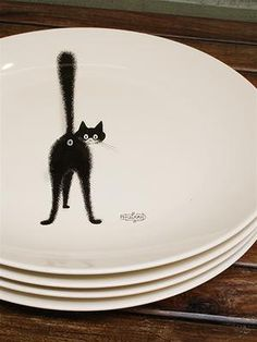 """Cat demonstrating her pose """"Greeting the Preacher""""  --   by French illustrator Albert Dubout -- he titled this """"The Third Eye.""""  Plate is part of a French collection decorated with his illustrations from the 1930's, featuring moments of feline humor and expression of opinion."""