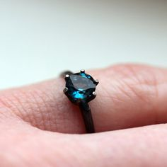 6 mm London Blue Topaz Solitaire Ring in Oxidized Sterling Size 6.75 to 8, seller on Etsy is TheFlyingFoxArts