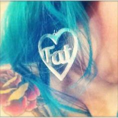 @magicalfifimulaa wearing http://sortlifeoutbuymilk.blogspot.co.uk mirrored silver fat heart word earrings