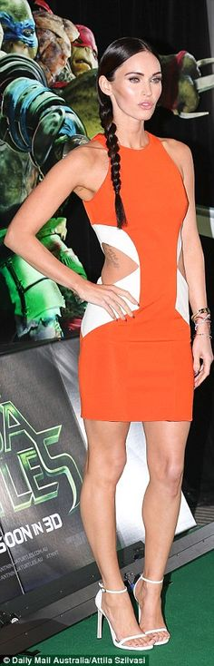 Brunette beauty: Posing on the green carpet at the event, Megan had hearts racing as a gli...