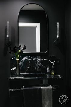 2019 interior design trends - An All black bathroom with black painted walls and a white and black marble pedestal sink. Arched mirror with matching cylinder sconces. Black Painted Walls, Black Walls, Black Ceiling, Best Bathroom Designs, Bathroom Trends, Bathroom Ideas, Black Interior Design, Bathroom Interior Design, Black Room Design