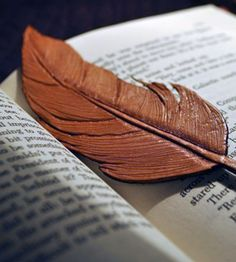 Leather Feather bookmark. I need to try one of these. It would be such a fun project.