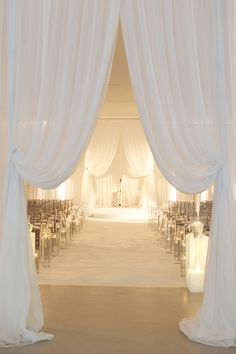 White drapery at indoor wedding ceremony - beautiful wedding aisle!  ~  we ❤ this! moncheribridals.com