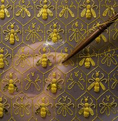 "Constellation of 69 bees, the symbol of the Empire and the emblem of the Guerlain family of ""Eaux"". Sylvie Deschamps, Maître d'art, handcrafts ""The Festive Attire"", ""L'Habit de Fête"", a covering designed as an imperial coronation robe"