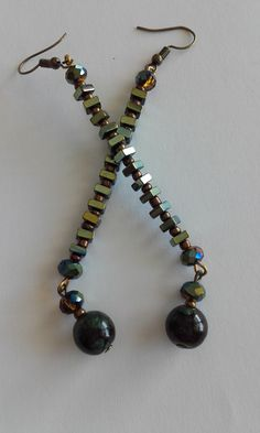 Dangle & drop multi color earrings / Semiprecious beads (Hematite) / Glass beads / Crystal beads / Minimal earrings Length : cm Drop length : 8 cm Width : cm Weight : 5 grams (each) Crystal Beads, Glass Beads, Crystals, Earrings, Dangles, Minimal, Beaded Necklace, Shop, Handmade