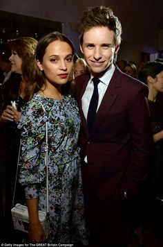 Strike a pose: Vikander was reunited with her dapper co-star Eddie Redmayne at the party...