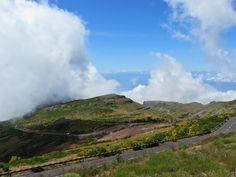 Clouds above the mountains and the Ocean on the background. Madeira Island, Portugal.