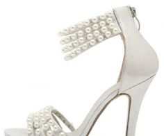 The stiletto casual heels feature faux PU material, strappy cutout design, chic beads decor, peep toe look, single sole style. spenditonthis.com