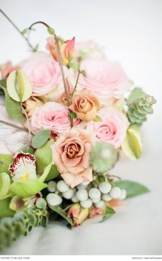 Feminine wedding bouquet with greenery and pink and gold roses | Flowers: Afresh Events
