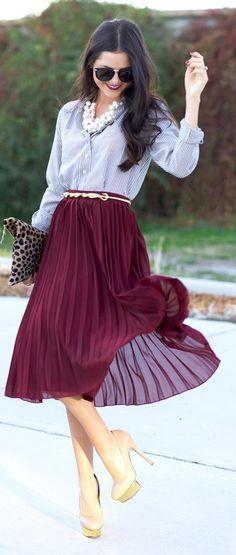 Burgundy pleated skirt with light gray blue blouse.