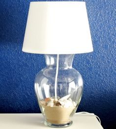 Make a Lamp from a Vase or Jar that you can fill with beach finds: http://www.completely-coastal.com/2013/08/make-lamp-vase-jar-filled.html