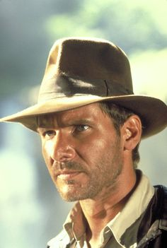 """Harrison Ford in """"Raiders of the Lost Ark"""" (1981) There's somethin' about a man who knows how to do adventure and ain't afraid to take a risk....on top of that Rugged good looks...whoo hoo!!"""