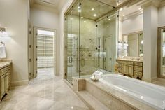 The tub and shower split this Master Bath down the middle, leaving separate dressing areas, etc. that are still open to each other...