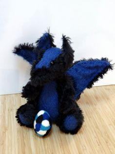 Keagan is a one of a kind artist mohair dragon, designed and crafted by me. He is 26 cm/10 inches. He is entirely hand stiched. Wings and ears with…