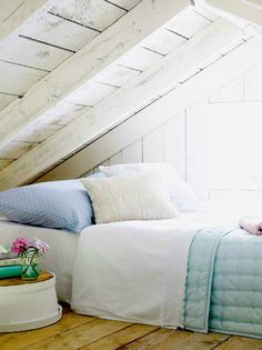 low-ceiling attic summer-bedroom with no insulation in roofing construction