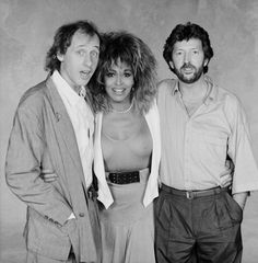 From left to right British musician Mark Knopfler of Dire Straits American singer Tina Turner and British guitarist and composer Eric Clapton 23rd...