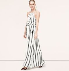 """Slim stripes evoke a long and lean effect along this tassel-topped style. Halter ties at back neck. Sleeveless. Gathered elasticized waist with tasseled ties. Lined skirt, unlined bodice. 41 1/2"""" from waist seam."""