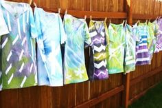 Spray tie dye- add stickers and masking tape first to make the white design, then spray to dye.