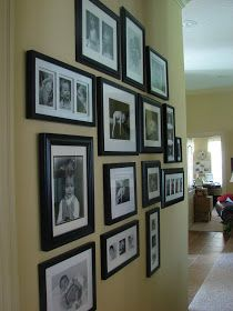 Simple black frames and white mat, mixed sizes, well designed layout.