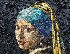 The Girl with a Pearl Earring by Jan Vermeer interpreted with buttons and beads.