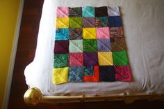 Mitered square blanket, knit (join) as you go. Free pattern.