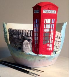 Underglazed traditional British telephone box yarnbowl. Another photo to follow of the glazed result which will be grass green inside and sky blue outside.  earthwoolfire@gmail.com earthwoolfire.etsy.com