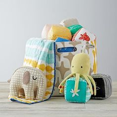 This exclusive gift bag is more than just a gift bag. It's like five gifts in one. That's because it includes a reusable gift basket, blanket, block set, stroller toy and plush. It also makes a perfect baby shower gift.