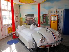 Sleep at the V8 Hotel in Stuttgart >>> a car lover's dream! There are a number of theme rooms rooms decked out to look like a camper, Route 66, and a car wash, just to name a few. There is also a car museum and dealership right inside the hotel, and all the theme rooms overlook the museum for a garage-like feel. If you don't want to sleep in a car-turned-bed, there are also regular rooms available that still have fun automobile themed touches like car-shaped soaps.