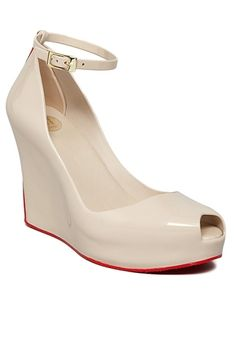 Melissa Patchuli II - Beige/Red from Melissa Shoes at StriveGreen Melissa Plastic Dreams Patchuli II just may be the most comfortable heel you ever wear! Neutral beige tone is accented with red sole and back stripe. Adjustable ankle strap, peep toe style.