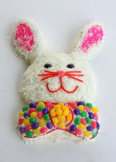 Easter Bunny Cake  (been doing this one for 20 yrs.  Use 2 round pans, one of the pans you cut the ears out and the center becomes the bow).  Instead of the Jelly Beans I just put some coconut in a bag with food coloring & shake then filled in the bow & ears.