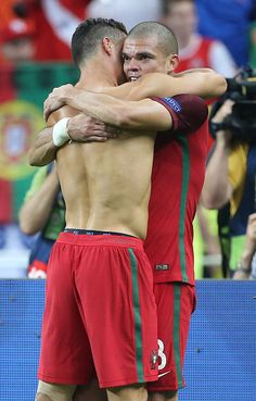 #EURO2016 Cristiano Ronaldo and Pepe of Portugal celebrate the victory following the UEFA Euro 2016 final match between Portugal and France at Stade de France...