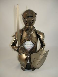 Armor with Sword Metal Wine Bottle Holder by China. $29.99. Contemporary decorative metal wine holder simple but elegent.. Each piece is unique,personalized and reflect a personality for a better gift experience.. Decotative piece is perfect gift to persent a bottle of wine.. Highest quality Iron and Metal with plated black Nikel on surface.. Armor Figurine Type Metal Wine Holder