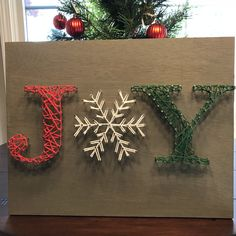 "JOY String Art 11"" x 17"" -   Craft an unique piece of string art to celebrate the season. We provide the pattern and a wide variety of string colors to choose from. Book a party today and celebrate with some of your friends."