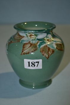 Small Newtone pottery vase, hand painted and signed D. Myrton, height 9.5cm