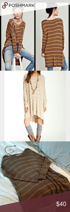 Free people shipping news hi low tunic sweater Light knit slouchy hi low Tunic length with side slits.  Brown gold combo (pic 1,3) Medium  Worn once hand washed Free People Tops Tunics