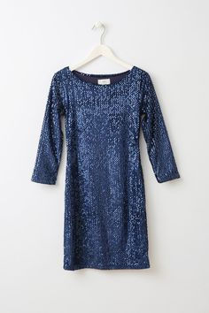 Diona Blue Sequin Dress Amazing and fitted blue all over sequin dress from Danish brand Minimum. The sleeves are 3/4 length and the neck isn't too low but the dress is still super sexy as it's well fitted and short. It has a zip in the side to make it easy to put on.