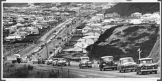 Queue of cars driving on a newly sealed road at Wainuiomata, 25 March The Hutt County Council was using motorists to consolidate the chips in. Small Luxury Cars, The Hutt, New Trucks, British Isles, Heavy Equipment, Old Pictures, Used Cars, Cars For Sale, New Zealand