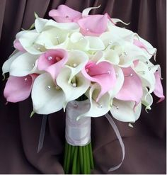 **Use these as bridal bouquet (calla lilies-light pink and white), silver ribbon around stems, malibu ribbon hanging (to match bridesmaids dresses)