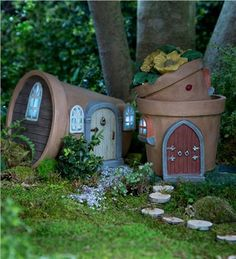 Solar powered fairy houses light up at night! Cute ! I want these for a corner of my garden