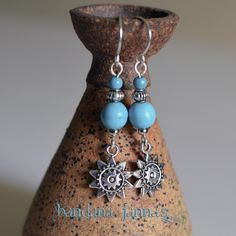 "These sunny earrings dangle at 2 1/4 inches with silver plated handmade hooks & turquoise colored howlite beads.   Please visit & ""like"" me on FaceBook & be notified of Give-Aways!"