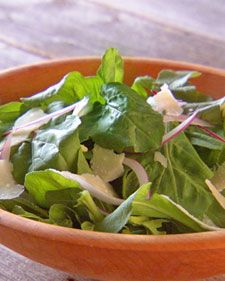 "Arugula Salad with Shaved Parmesan  This clean, simple salad has lots of bright flavors from the red onion, lemon juice vinaigrette, and arugula.  Serve it after the main course or put on a new spin on it by adding grilled shrimp or using it as a pizza topping.  From the book ""Lucinda's Rustic Italian Kitchen,"" by Lucinda Scala Quinn (Wiley)."