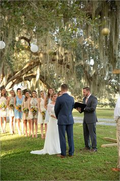 outdoor wedding ceremony under a tree. So Sweet
