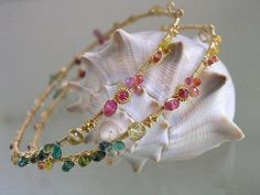 South of the Border.....Pulsing Ruby Sapphire Tourmaline Dressed Signature Original Gold Filled Hoop Earrings. $338.00, via Etsy.