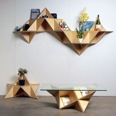 T.SHELF (Triangular shelf) is a modular system that can be built into multiple shapes with various functions. / by j1studio