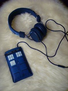 TARDIS iPhone case and matching headphones. (What if you made the 'whoosh' sound your ringtone?)