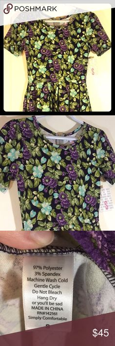 "LLR Amelia Dress Size Small Navy background. Gorgeous floral design: lots of green leaves w/ Purple and blue flowers. Stretchy, kind of ""bouncy"" feeling material. Smoke free home. LuLaRoe Dresses Midi"