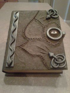 Impressive homemade evil spell book (modeled after of Hocus Pocus spell book).