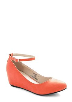 Looks like an old pair from Aldos I had to throw away even though I loved them! Take a Stride With Me Wedge in Coral, #ModCloth